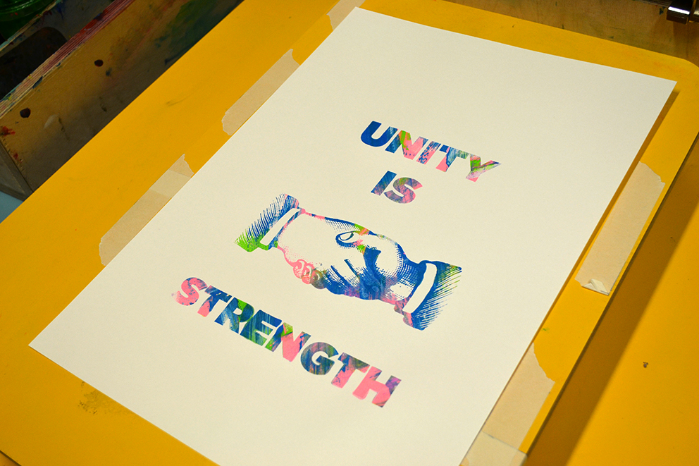 unity is strength colourful writing, shaking hands