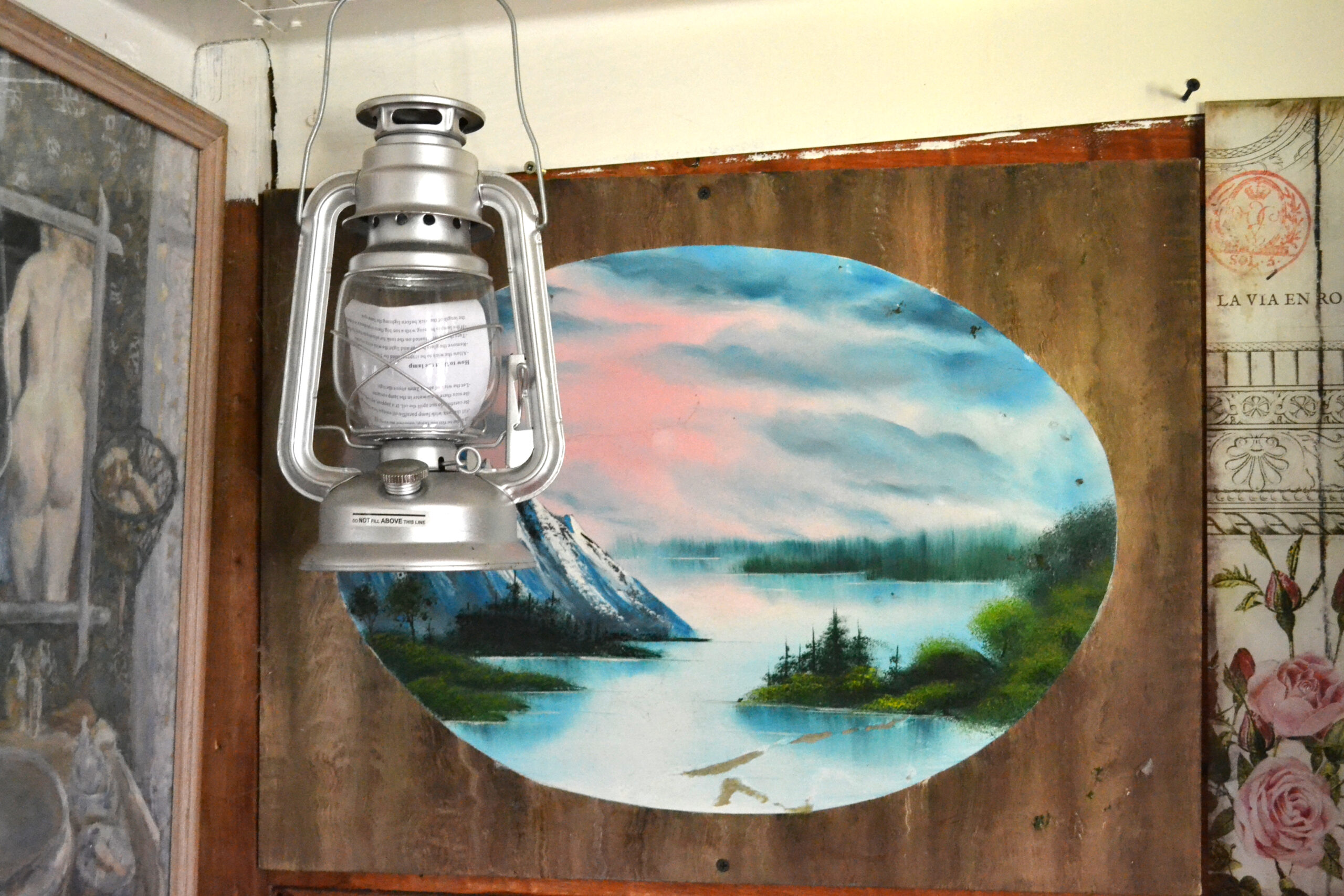 lantern hanging in front of a seascape on a door
