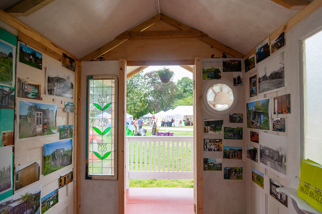 inside a shed full of paintings. Grandad's Island at Walthamstow Garden Party 2019